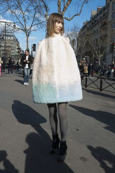 street style: Paris Fashion Week Fall 2014... Anya Ziourova's cape provided ample texture and warmth.