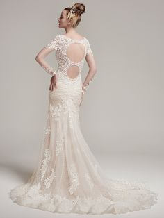Sottero and Midgley - MELROSE, Modern lace appliqués adorn the illusion long sleeves, fitted bodice, and scalloped hemline of this crosshatch tulle over jersey fit and flare wedding dress. Complete with illusion sweetheart neckline, double illusion keyhole back, and dramatically sweeping train. Finished with crystal buttons and zipper closure.