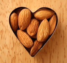 Almonds - just an ounce a day raises metabolism, lowers Alzheimer's risk, plus a great source of antioxidants and vitamin E.  With only 24 almonds daily, you won't gain weight! Thanks, Carson City Wold Fitness!