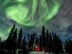 North Pole, Alaska. Private, Waterfront Cabin Among Trees with Aurora Borealis and Wildlife Viewing