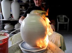 This video explores the use of a flame torch to throw exaggerated shapes on the potters wheel. Flaming the pot at various stages stiffens the clay just enoug...