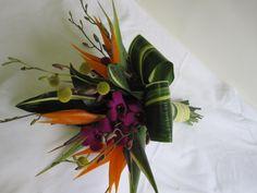 H.J. Benken Bridal Bouquet with Billy Balls, Dendrobium Orchids, and Birds of Paradise by Benkens.com #Tropicalbridalbouquet