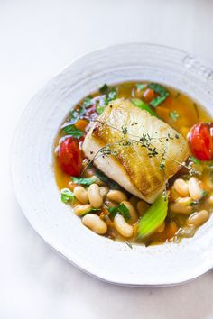 Sea bass w/Cannellini Bean Stew. This soulful bowl of Cannellini Bean Stew is topped w/ Seared Sea Bass. Comforting and warming this healthy meal only takes 30 mins. Fish Recipes, Seafood Recipes, Cooking Recipes, Seafood Dinner, Fish And Seafood, Easy Delicious Recipes, Healthy Recipes, Masterchef, Bean Stew