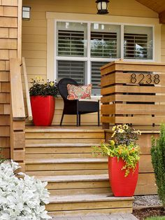 Use fun containers to spruce up your home's outdoor appearance. More curb appeal on a dime: http://www.bhg.com/home-improvement/exteriors/curb-appeal/curb-appeal-on-a-dime/?socsrc=bhgpin081113flowercontainers=1