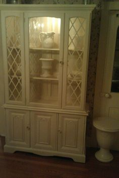 First China Cabinet with hand striping inside back...