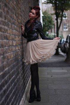 fashion event style: GIRLY BIKER. what a great example of this look.  the feminine pink chiffon mixed with hard edged biker is amazing for a fashion party!