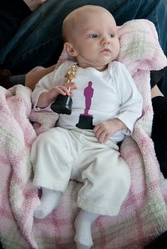 Someday, I would like to be married and have a baby. And that baby will wear this at the annual Oscars party. Adorable!