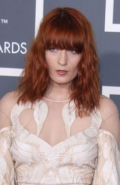 Florence Welchs red hairstyle with bangs
