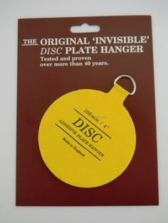 Invisible Adhesive Disc Hanger to Hang an 8.5 -12  Plate or Platter on the Wall (other sizes available to accommodate any size plate) #4 & The plates are hung using adhesive discs. The 4