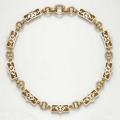 AN ANTIQUE BICOLORED GOLD NECKLACE   Composed of a series of rose and yellow gold panel links, each centering upon a heart motif, joined by rose and yellow gold arched and circular link spacers, circa 1860, 16¾ ins.