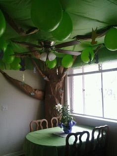 Easy Pixie Hollow tree for Tinkerbell party! Brown wrapping paper, green plastic table cloths and green balloons, all from the dollar store.