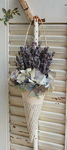 Dried flowers in paper cone...lettering on clothes pin.
