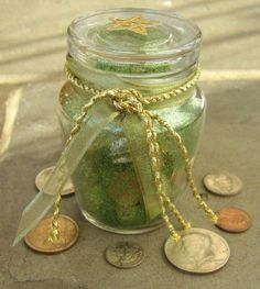 Money Spell Bottle 5 old pennies 5 dimes 5 quarters 5 kernels of dried corn 5 sesame seeds 5 cinnamon sticks 5 cloves 5 whole allspice 5 pecans Place each item into a thin, tall bottle, such as a spice bottle. Cap it tightly. Shake the bottle with your projective hand for five minutes while chanting these or similar words: Herbs and silver, Copper and grain; Work to increase My money gain.