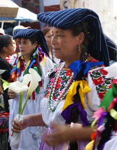 Purépecha women in Michoacán's Zona Lacustre ordinarily use a region-specific blue and black striped rebozo (shawl).  Legend has it that this traditional style rebozo became popular in Colonial times: the black stripe symbolizes Spanish hair, the blue stripe symbolizes the Spanish eye.  In daily life, the rebozo is utilitarian.
