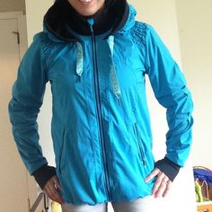"""Lululemon Running Jacket Previously owned.  No tag but would guess a size 6.  Lightly worn with small signs of wear.  Great condition except for hood ribbons have a less than 1"""" section that look like Italy has heated up a bit and """"melted"""" (for lack of a better word.  It is still fully functional. It just has a tiny section that is firmer than the rest.  Super cute pleated design that is very flattering.  Soft,  brushed breathable lining.  Thumb holes! Mesh vented pits and zippered pockets…"""