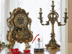 Beauty And The Beast Cogsworth clock & Lumiere light Set. Cogsworth watches : height about 32 × width 21 × depth 12 cm. Lumiere light : height about × width × depth World limited Be Our Guest.