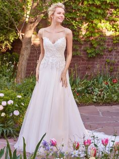 Rebecca Ingram - MARJORIE, Flirty strap details create a crisscross effect that accents the open plunging back in this tulle A-line. Featuring a beaded lace bodice, V-neck, and flowing train. Finished with zipper closure.