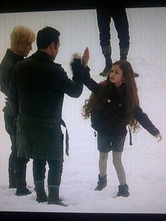 Mackenzie Foy behind the scenes breaking dawn part 2. Playing hand games while they wait to be filmed.