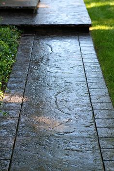 Seamless Stamped Concrete sidewalk with hand tooled border and porch with 2 inch rough granite overhang - increte medium natural brown with dark grey antiquing release agent. By The Concrete Artisans, Inc. by The Concrete Artisans, Inc., via Flickr