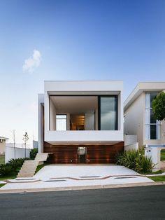 jolie masion blanche avec architecture minimaliste                                                                                                                                                                                 Plus