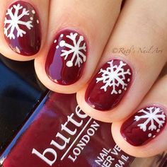 A beautiful and rich red topped with snowflake details by @ruthsnailart. ❤❄ #nailitdaily #winternails #snowflakenails #nailart #notd