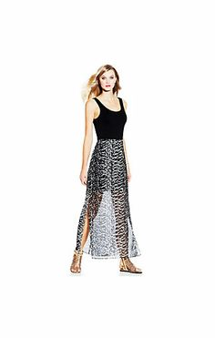 Animal Tracks Overlay Maxi-A solid dress gets wild with a printed chiffon overlay skirt. Add a silver necklace and buckled wedges to complement the Animal Tracks Overlay Maxi from Vince Camuto. •96% Rayon, 4% Spandex