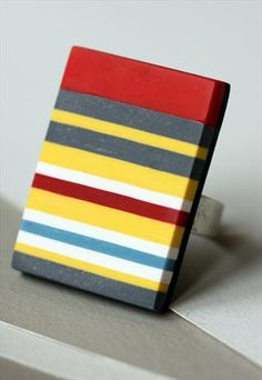 Bright yellow and grey with some white and red stripes ring
