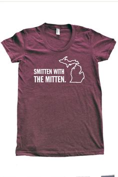 """Michigan Awesome Tee - The perfect gift for the traveler or the young adult away at college…the Michigan Awesome Tee.  """"Home is Where the Hand is"""" available in Navy.  """"Smitten With the Mitten"""" available in heathered plum.  50% Cotton/50% Polyester.  Sizes S-XL (fitted tee runs small).  Made in the USA.  Printed in Michigan. - $28"""