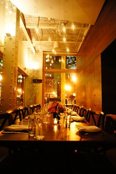 the private dining room at night prepared for a twelve person dinner party - Private Dining Room Boston