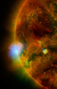 NuSTAR Stares at the Sun | Flaring, active regions of our sun are highlighted in this new image combining observations from several telescopes. High-energy X-rays from NASA's Nuclear Spectroscopic Telescope Array (NuSTAR) are shown in blue; low-energy X-rays from Japan's Hinode spacecraft are green; and extreme ultraviolet light from NASA's Solar Dynamics Observatory (SDO) is yellow and red.