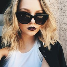mid-length blonde bob with oxblood colored lipstick