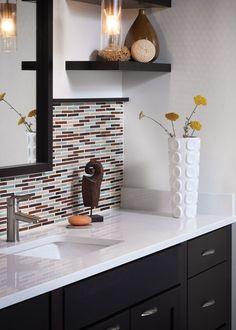 Love the crisp white quartz countertop with the dark cabinets, and awesome backsplash tile.
