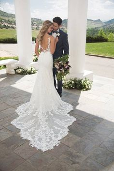 Lace wedding dress with train and open back style 1059 by martina liana love this martina liana gown learn more about it and where to find it on weddingwire! rebecca 2071 a line wedding dress by morilee by madeline gardner weddingwire com Most Beautiful Wedding Dresses, Top Wedding Dresses, Wedding Dress Trends, Bridal Dresses, Bridesmaid Dresses, Lace Wedding Gowns, Wedding Ideas, Aline Wedding Dress Lace, Wedding Dress Websites