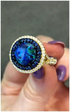 A stunning opal, sapphire, and diamond ring by Omi Prive. Spotted at the 2018 AGTA GemFair.