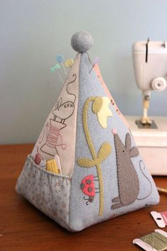 Mouse pincushion front - other side has needlebook and pocket for small scissors.
