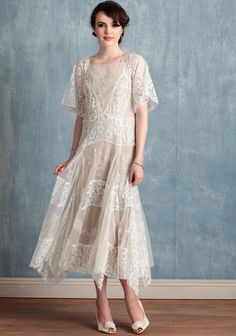 "Vivian 349.99 at shopruche.com. We're smitten with this vintage-inspired ivory tulle dress beautifully detailed with glowing lace accents and romantic floral embroidery. Perfected with sheer scalloped sleeves, raw-edged details for texture, and a charming asymmetrical hem. Includes a removable beige cotton slip. Sheer.  Shell: 100% Nylon, Lining: 100% Cotton, Imported, Model is 5'9"", See size chart below for specific measurements"