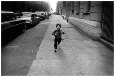 Photographed by Garry Winogrand - I like this image because the street is so empty except for a kid that is happily running. Garry Winogrand, National Gallery Of Art, Diane Arbus, New York Photographers, Susan Sontag, Edward Weston, Shooting Photo, Documentary Photography, Black And White Photography