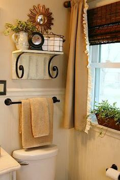 For the guest bath? 11 Fantastic Small Bathroom Organization Ideas: Put a shelf over toilet bathroom storage idea from The Butlers Small Bathroom Organization, Bathroom Storage, Organization Ideas, Toilet Storage, Storage Ideas, Shelf Ideas, Bathroom Wall, Bathroom Shelves, Warm Bathroom