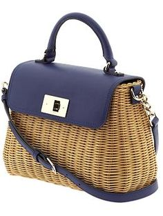 Kate Spade. Been really lovin' this season's handbags. This has got to be the cutest looking picnic handbag ever!