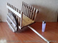 rustic wood cart - this one doesn't show each step - made from balsa wood - use chopstick for the pole - lots of step by step tutorials on this site - some very unique! guitar, rifle, chest, and lots of really cute furniture - all can be suitable for both dollhouses and fairy gardens