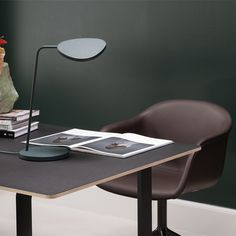 A modernly timeless addition to any home or professional space, the Muuto Leaf Table Lamp features organic lines that reference the leaves of a tree, paired with its turnable head and dimmable, LED light. Use the design in the home office, windowsill, on a nightstand, in educational settings or anywhere within the modern workplace. It was designed by Broberg & Ridderstrale.