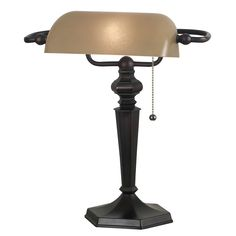 The traditional design of this classic bronze desk lamp provides a stately addition to any lighting scheme or decor. With sturdy construction and an amber glass shade for soft illumination, this lamp offers an eye-catching accent for any desk or table.