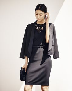 A hint of lace makes Ann Taylor's black ponte sheath and shawl-collar jacket feel feminine, yet refined.