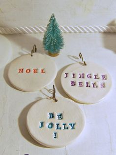 $10.00 -3 White Fired Clay Christmas Ornaments / Set of three / Stamped Highlighted Accented Sealed / Jingle Bells / Be Jolly / Noel