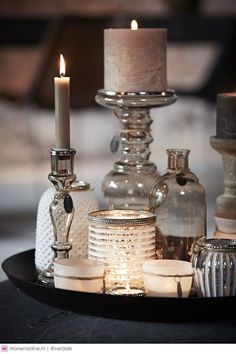 pretty coffee table. different candles, jars,bottles decor