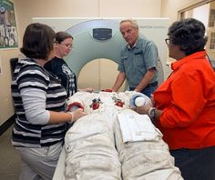 Anthropologist Bruno Frohlich (in blue) of the National Museum of Natural History performed a CT scan of Neil Armstrong's Apollo 11 spacesuit in October 2014.