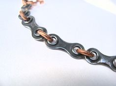 design squish blog... from bike chainlike  love this! with a colorful cord? could be really fun and easy???