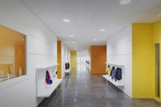 Lucie Aubrac School / Saison Menu Architectes Urbanistes, coat hooks, benches, hallway, acoustical tile ceiling, polished concrete floor, relites
