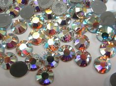 Items similar to Genuine SWAROVSKI Crystal Elements Hot Fix FlatbackS In ALL Colors and Sizes on Etsy