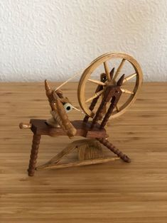 Excited to share this item from my shop: Miniature hand carved wooden spinning wheel with working wheel and pedal